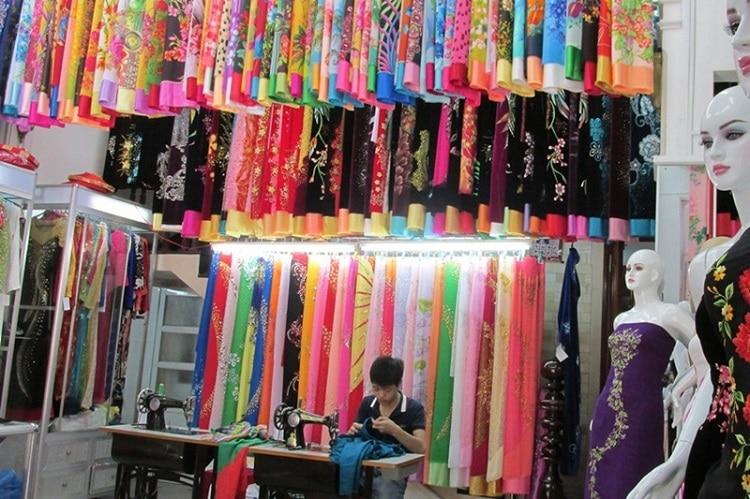 Top địa chỉ mua vải và may áo dai đẹp nhất Huế - Tham